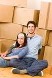 Moving new home young couple sitting floor Royalty Free Stock Photography