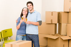 Moving into new home young couple toast stock photography
