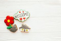 Moving in new house, Welcome home set. House, plant,heart, welcome sign cookies on white wood, flat lay with space for text. Dream. Home concept. Home Sweet stock images