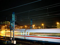Moving in the night. A fast train in the night Royalty Free Stock Image