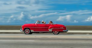 HAVANA, CUBA - OCTOBER 20, 2017: Moving Old Car in Malecon, Havana. Cuba. Sightseeing Tour with Tourist. Moving Old Car in Malecon, Havana. Cuba. Sightseeing Royalty Free Stock Photography
