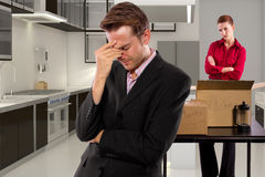 Moving Out. Young caucasian couple breaking up and moving out Royalty Free Stock Photography