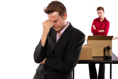 Moving Out. Young caucasian couple breaking up and moving out Stock Photos