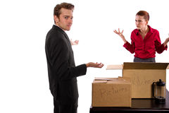 Moving Out. Young caucasian couple breaking up and moving out Royalty Free Stock Photos