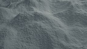 Moving over cement powder. Dolly shot moving slowly over pile of grey cement powder stock video