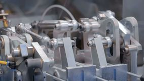 Moving parts of industrial automotive machine tool equipment. Abstract industry, engineering, machinery, manufacturing, production process and automated stock video footage