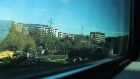 Moving in a Passenger Train and View out of Buildings and Trees stock footage