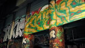 Moving Past Graffiti In Abandoned Building stock footage