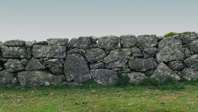 Moving Past Old Stone Wall In The Country stock footage