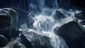 Moving Past Rocky Waterfall In The Mountains stock footage
