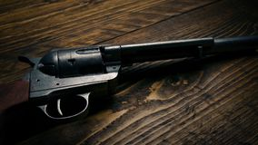 Moving past six shooter gun stock footage