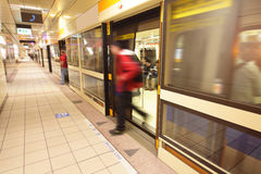 Moving people leaving train at metro station Stock Photography