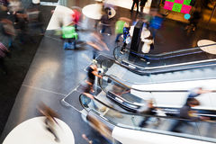 Moving people in a shopping mall Royalty Free Stock Photo