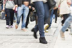 Moving people. People walking in a pedestrian mall holding shopping bags Stock Image