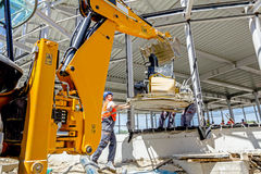 Moving power trowel machine with excavator on a new job site Royalty Free Stock Photos