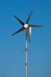 Moving propellor from a little wind turbine. In the clear blue sky of folegandros, Greece, 2013 Royalty Free Stock Images