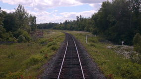 Moving railroad tracks. Train passing through countryside. 1080p stock video footage