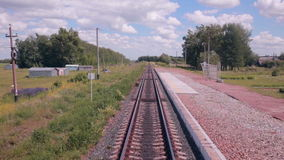 Moving Railroad tracks. Train passing through countryside. stock footage