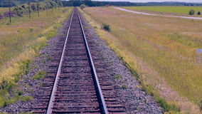 Moving Railroad tracks. Train passing through countryside. 1080p stock footage