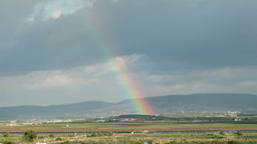 Moving Rainbow Over The Fields Of Galilee, Israel With Sun Rays stock video footage