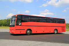 Moving Red Coach Bus Stock Image