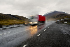 Moving red truck stock images