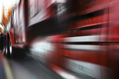 Moving red truck. Photo of moving red truck with motion blur Stock Photography