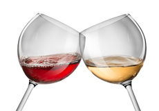 Moving red and white wine. Glass over a white background stock photo
