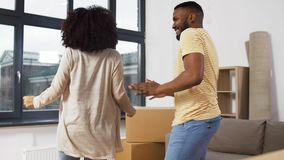 Happy couple moving to new home and dancing stock footage