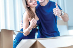 Moving, repairs, new flat. Couple girl and guy lie on the floor Stock Images