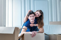 Moving, repairs, new flat. Couple girl and guy lie on the floor Royalty Free Stock Image
