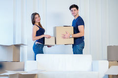 Moving, repairs, new keys to the apartment. Couple girl and the Royalty Free Stock Photo