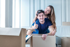 Moving, repairs, new keys to the apartment. Couple girl and the Royalty Free Stock Images