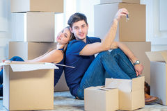 Moving, repairs, new keys to the apartment. Couple girl and the Stock Photo