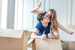 Moving, repairs, new life. Couple in love enjoys a new apartment Stock Photos