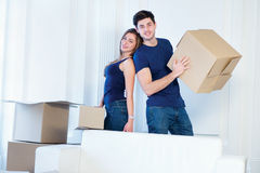 Moving, repairs, new life. Couple in love enjoys a new apartment Stock Photography