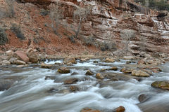 Moving river in red rock canyon, Zion National Park, Utah Royalty Free Stock Photography