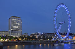 Moving / rotating  London Eye in the night with surroundings Stock Image
