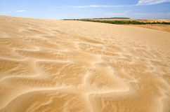 Moving Sands. Textured sand drifts across a sand dune Stock Photo