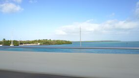 Moving scenery through the windows of a vehicle on the bridge road to Key West, Florida