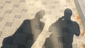 Moving shadows, men and women stock video