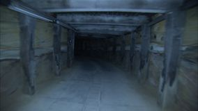 A moving shot of a tunnel. A shoulder shot of a tunnel. Camera moves forward stock footage
