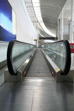 Moving Sidewalk. A moving Sidewalk in a curved hallway at an airport Royalty Free Stock Image