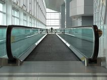 Moving sidewalk in airport stock images