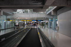 Moving sidewalk at an airport Stock Photo