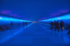 Moving sidewalks and a changing light show in the tunnel of the Detroit Airport, Detroit, Michigan Royalty Free Stock Images