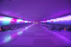 Moving sidewalks and a changing light show in the tunnel of the Detroit Airport, Detroit, Michigan Royalty Free Stock Photos