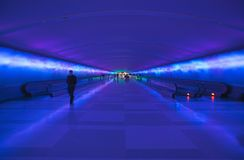 Moving sidewalks and a changing light show in the tunnel of the Detroit Airport, Detroit, Michigan Royalty Free Stock Photo
