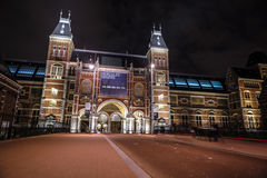 Moving silhouettes of cyclists and passersby near Rijksmuseum. Stock Photography