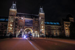 Moving silhouettes of cyclists and passersby near Rijksmuseum. Stock Photo